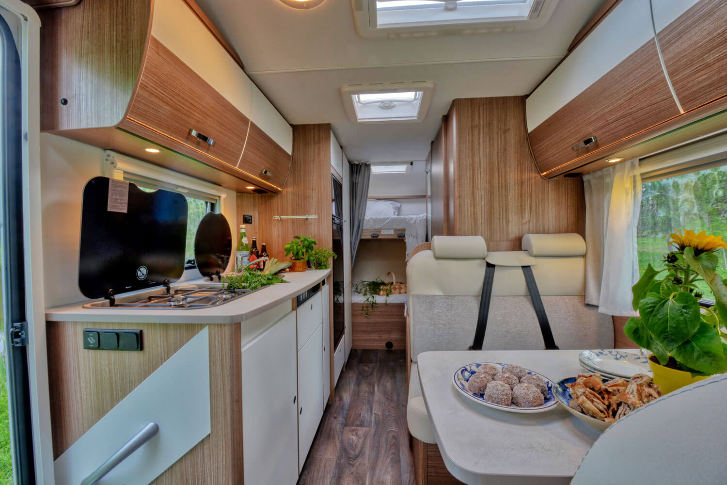 SkandiTrip family motorhome comfortable living room section and alcove beds